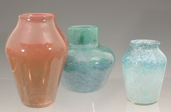 9:  Three Monart glass vases, . including an ovoid vase
