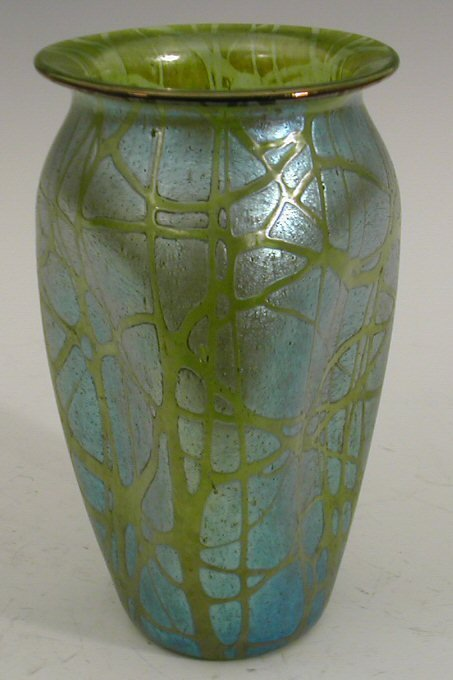 17:  A Loetz glass vase, . of dimple ovoid form with ev