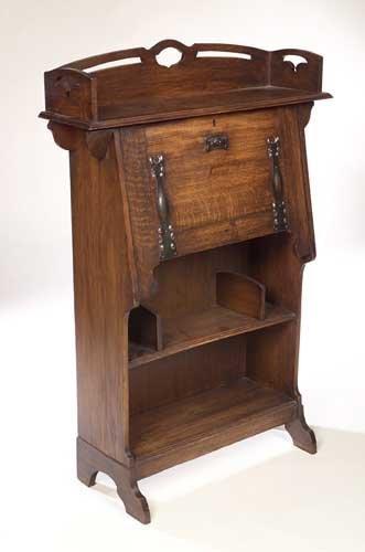 338A:  An Art Nouveau oak bureau, . the three quarter p