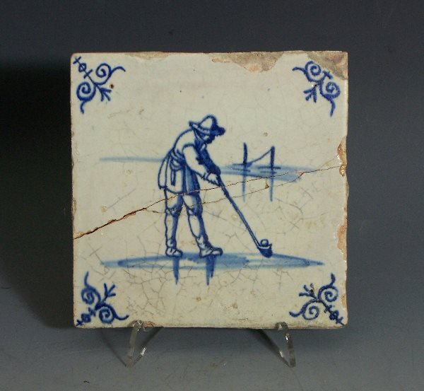 16: Golf: A Dutch tin glaze golfing tile, 13.5cm wide