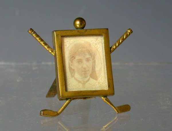 23: Golf: A miniature gilt metal photograph frame,