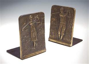 A pair of bronze golfing bookends, relief - cast res