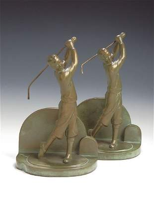 A pair of patinated bronze golfing bookends, each a