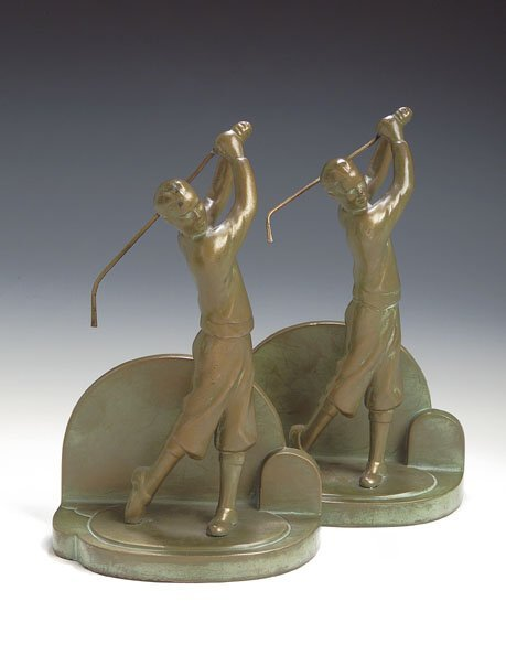 17: A pair of patinated bronze golfing bookends, each a