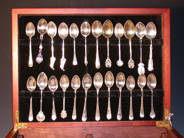 25: A collection of forty-eight silver golfing teaspoon