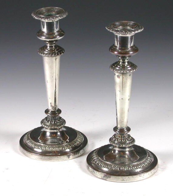 1002: A pair of Old Sheffield plate candlesticks, each
