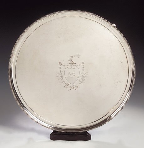 1003: A large plated salver, of circular form, with eng