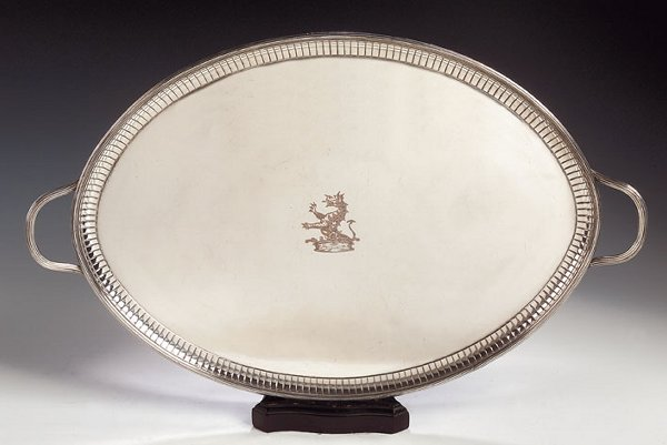 1004: A plated twin handled tray, of oval form, with en