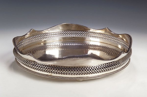 1008: A plated tray, with gadrooned and pierced waved g