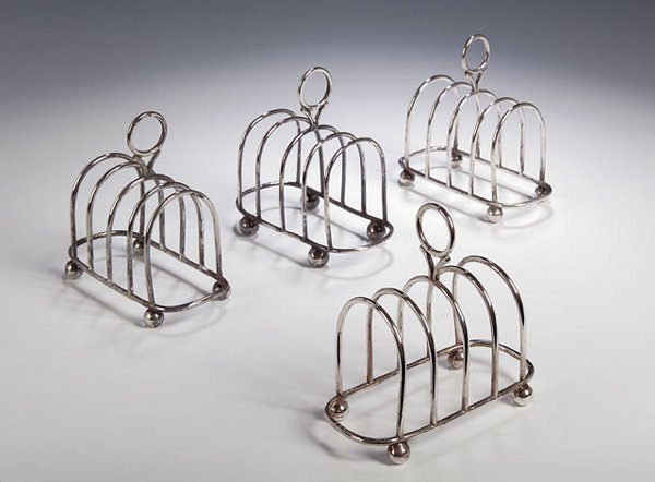 1022: A set of four silver toast racks, with marks for