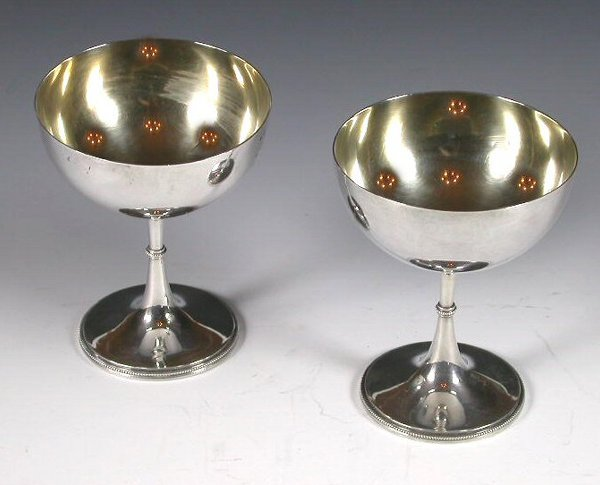 1023: A pair of Victorian parcel gilt silver chalices,