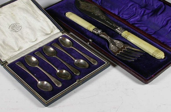 1024: A pair of Victorian silver fish servers, with mar