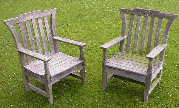 1290: A pair of Victorian weathered oak garden armchair