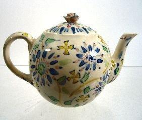 72: Jessie M. King (1875-1949) An earthenware teapot an
