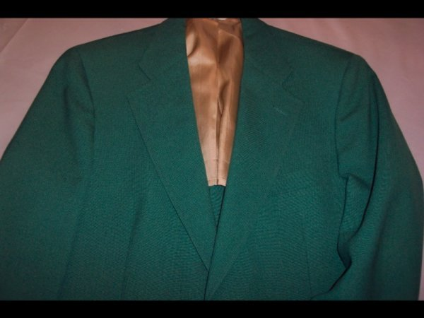 22: GREEN SPORTS JACKET  An emerald green two-button sp