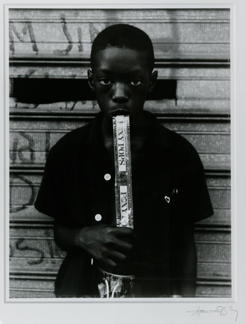 Dawoud Bey (American, b.1953) 'Boy Eating a Foxy Pop'