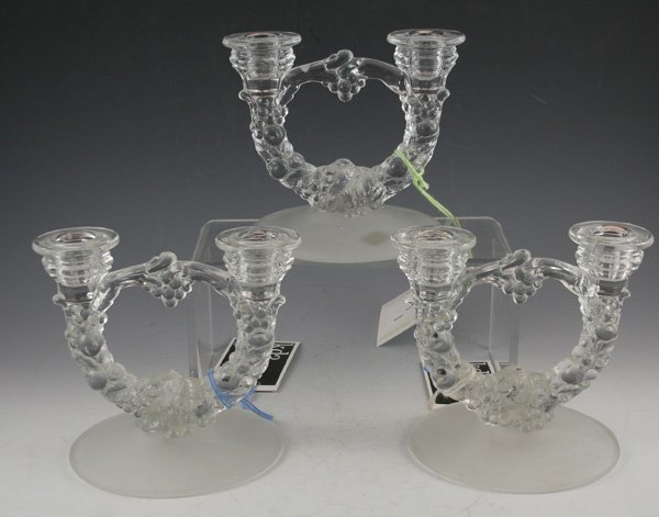 17: 17: Clear pressed glass two-lite candelabras.
