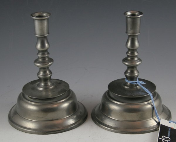 613: 613: Pair of pewter candlesticks.