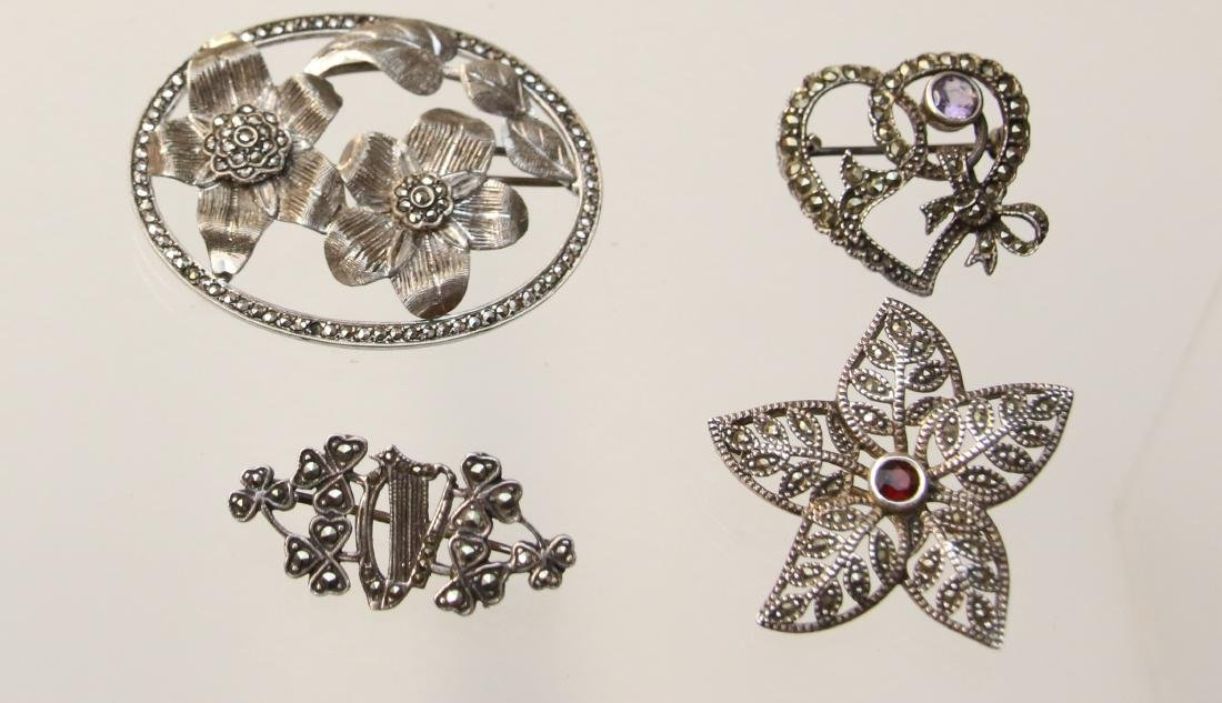 (4) STERLING AND MARCASITE BROOCH'S