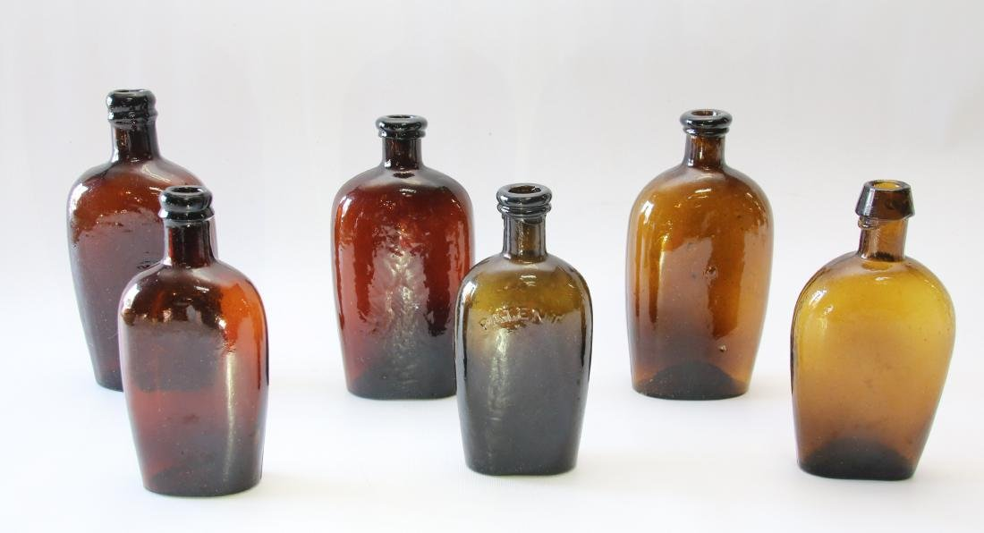 GROUP OF EARLY GLASS FLASKS