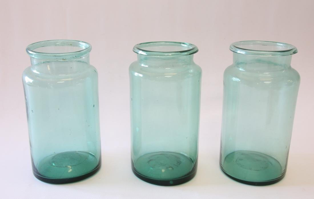 GROUP OF BLOWN GLASS STORAGE JARS