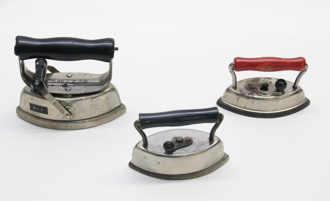 GROUP OF LITTLE ADVERTISING IRONS