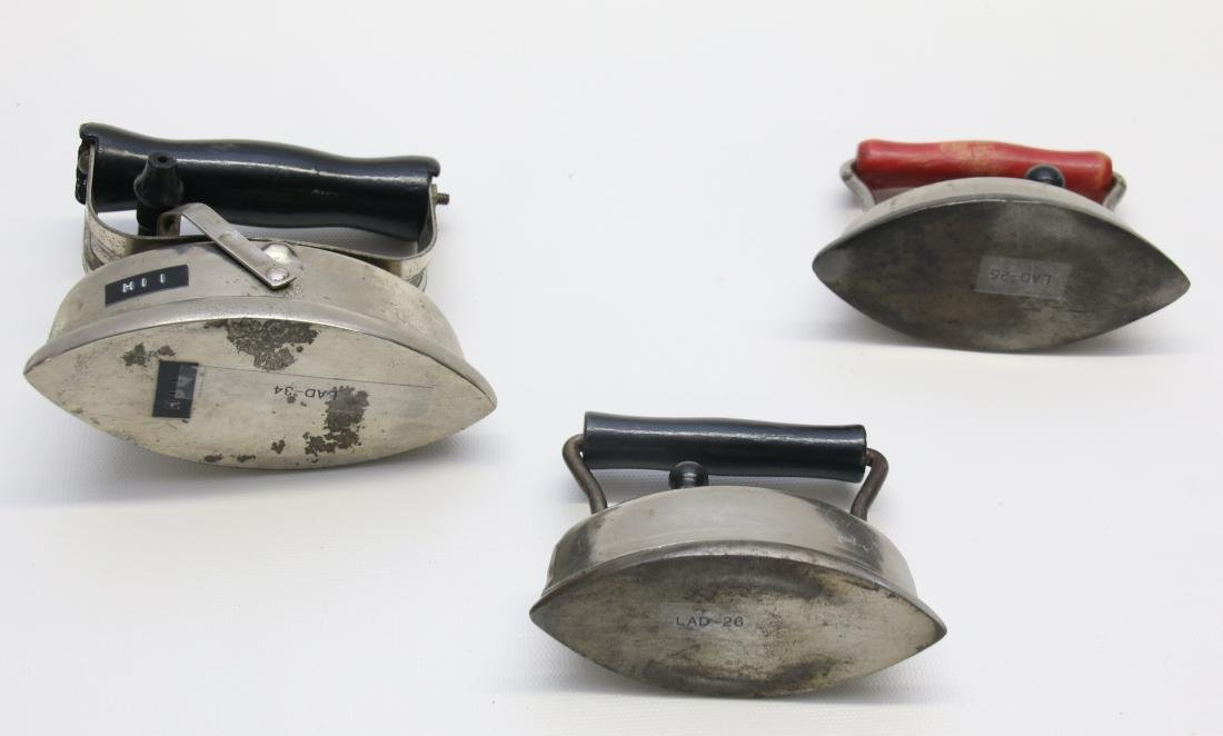 GROUP OF LITTLE ADVERTISING IRONS - 2