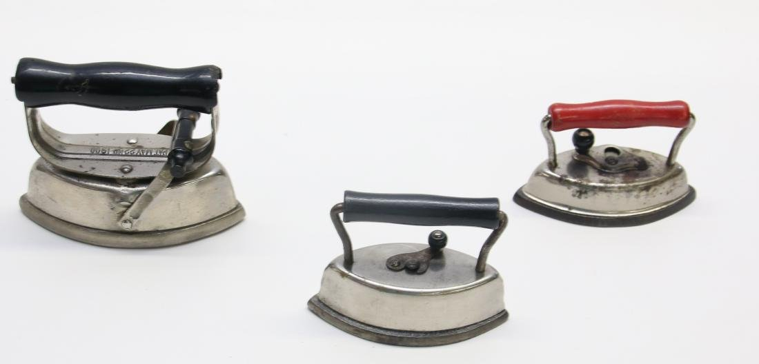 GROUP OF LITTLE ADVERTISING IRONS - 3