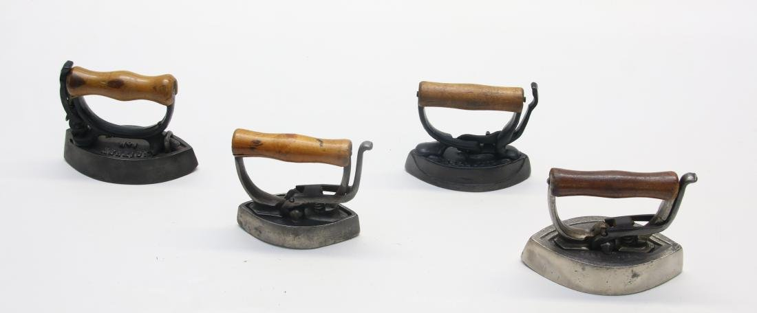 GROUP OF LITTLE DETACHABLE HANDLE IRONS