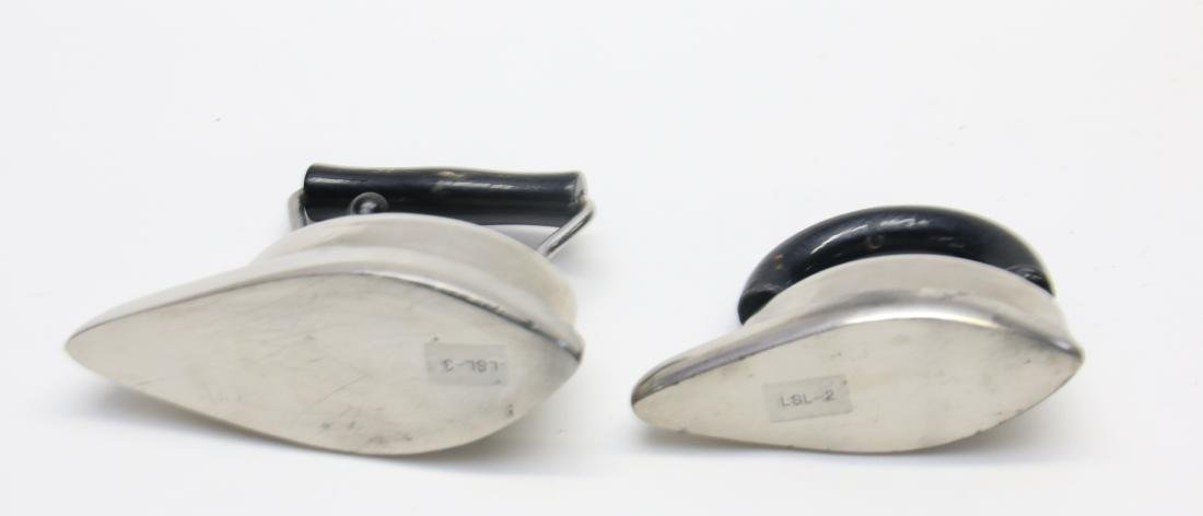 PAIR OF LITTLE SLEEVE IRONS - 4
