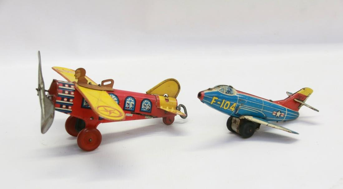 PAIR OF TIN LITHO CHILDS TOY