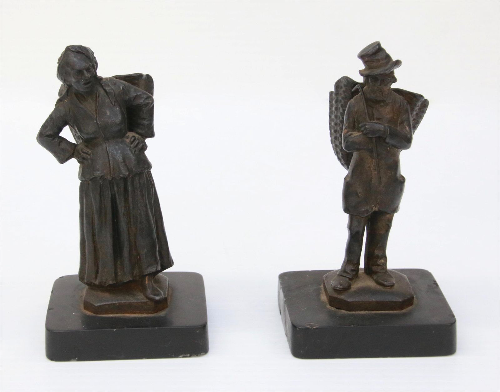 PAIR OF FIGURAL MATCH HOLDERS