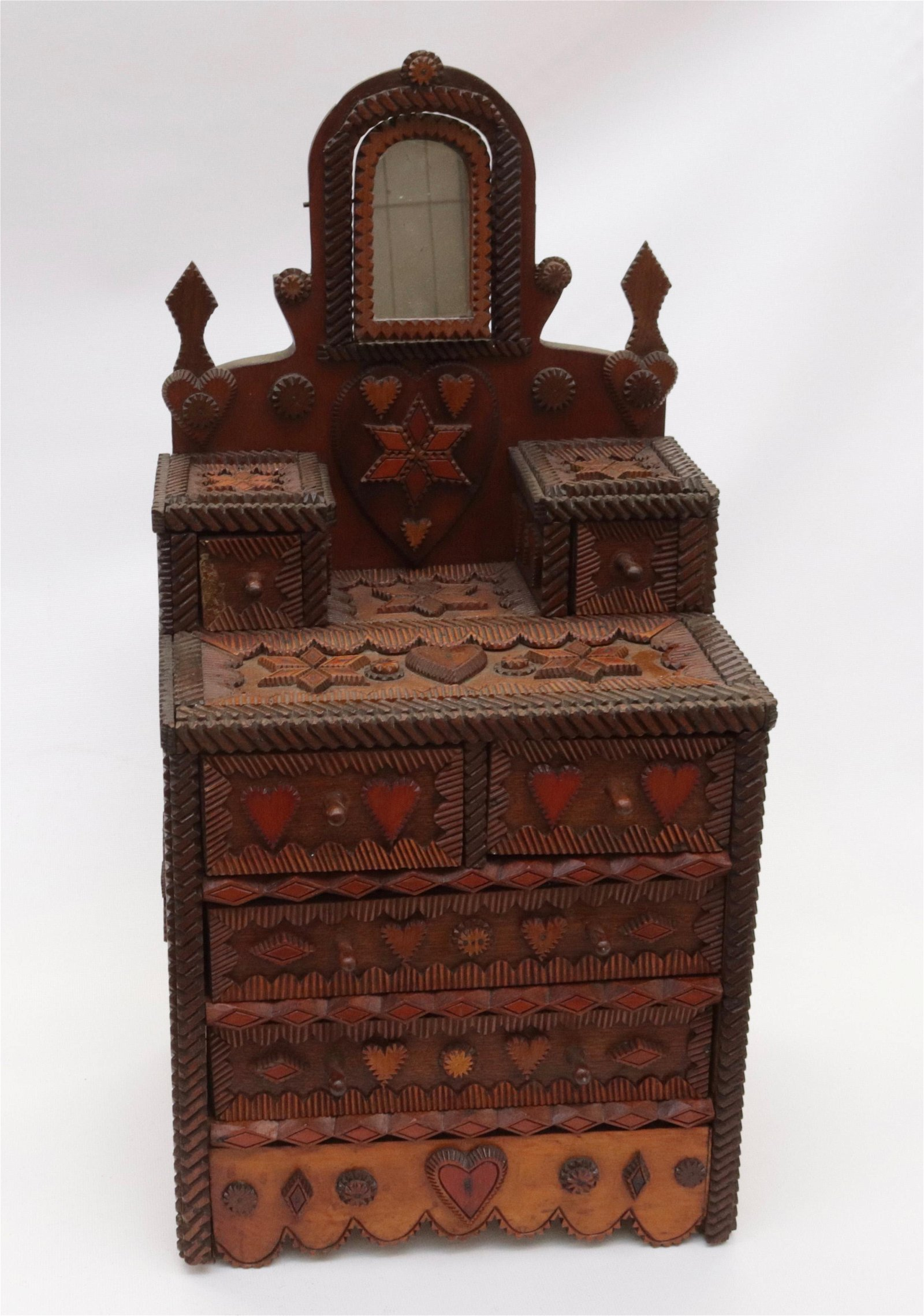 19TH CENTURY PROFUSELY CARVED TRAMP ART DRESSER