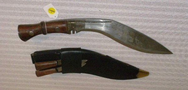 "1005:  LARGE CURVED BLADE KNIFE IN SHEATH APPROX. 17"" W"