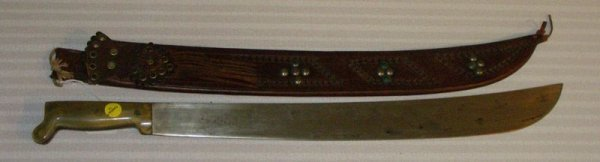 1017: BONE HANDLE MACHETE IN TOOLED LEATHER SHEATH MARK