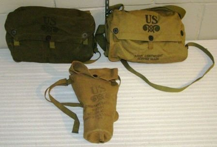 1030: (3) US MILITARY GAS MASKS ALL IN BAGS AND GOOD CO