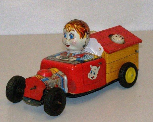 """4: 7"""" METAL FRICTION MAN DRIVING CAR W/ BOBBING PIGS T."""