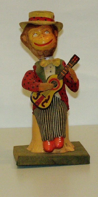 "10: 9 1/2"" TIN & CELLULOID MONKEY PLAY GUITAR WIND UP ("