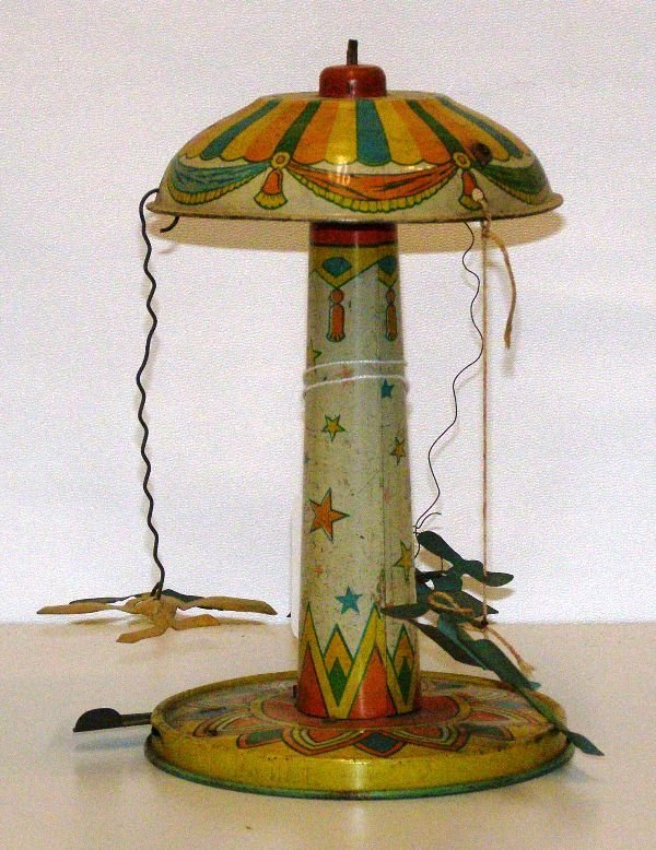 "13: 8 1/2"" TIN WIND UP CAROUSEL WITH 3 AIR PLANE - NOT"