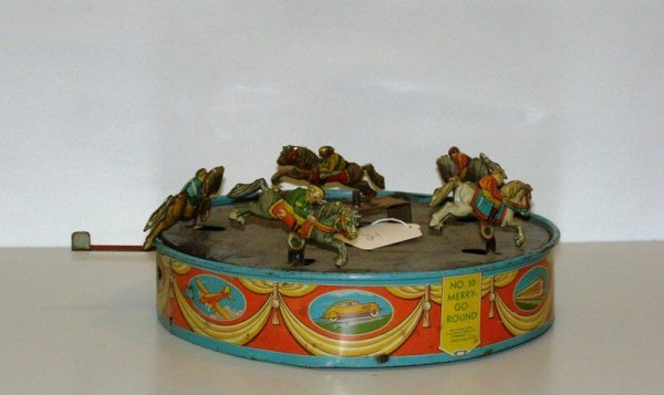21: TIN MERRY GO ROUND #30 WOLVERINE JUST BASE WITH RAC