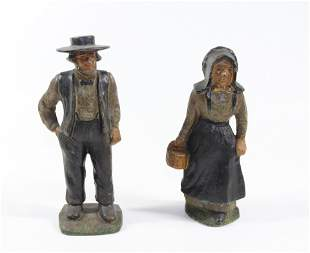 PAIR OF AMISH MAN AND WOMAN DOORSTOPS