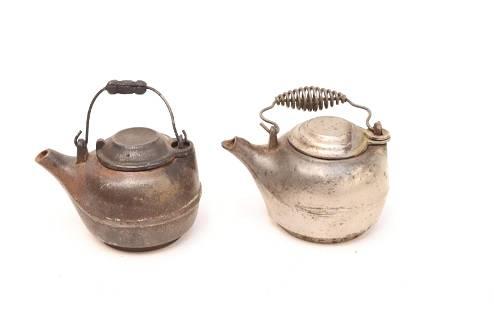 TWO CAST IRON MINIATURE TEA KETTLES