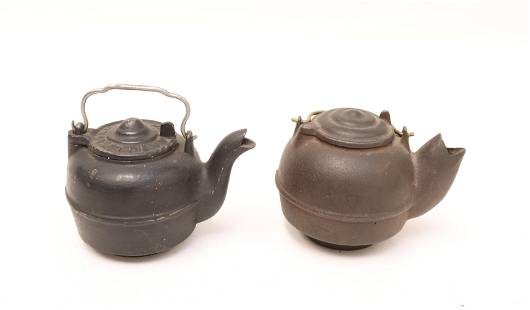 TWO MINIATURE CAST IRON TEA KETTLES