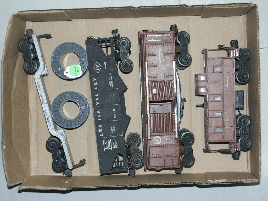 11:   BOX LOT OF LIONEL ITEMS 6561, 2456, 61100, AND 23