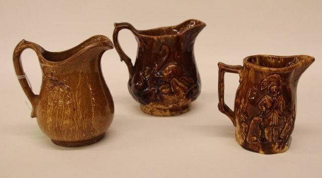 3 - ROCKINGHAM GLAZED PITCHERS