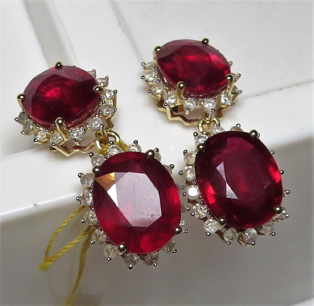 $7.7K  23.69 tcw. Ruby 1.28 tcw Dia Earrings