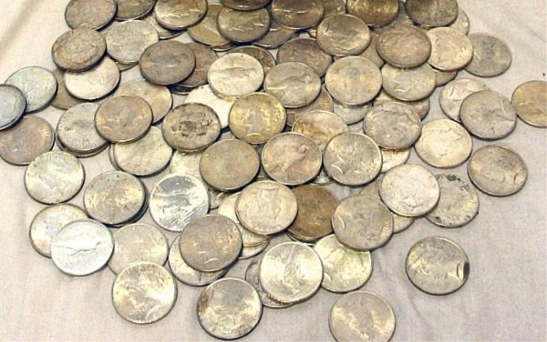 9: Lot of 17 Peace Silver Dollars