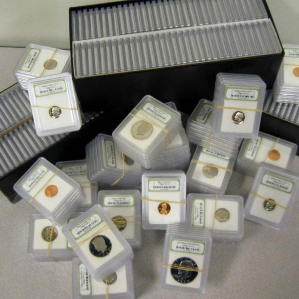 26: Lot of 100 Assorted Graded MS 69 Plus Coins