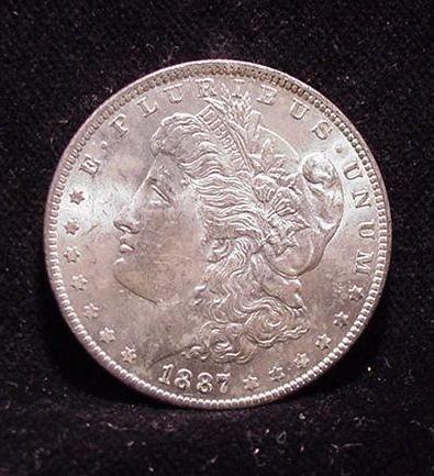 7S: 1887 Unc Morgan Silver Dollar