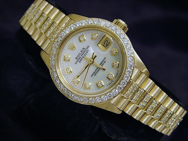 34E: LADIES 18K YELLOW GOLD ROLEX DATEJUST DIAMOND PRES
